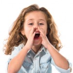 Blonde little girl shouting over white background