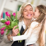 girl  giving flowers to his mom on mother's day